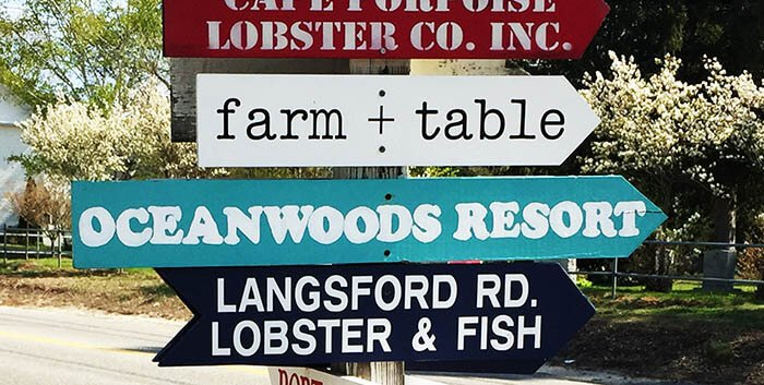 Wooden signs near your coastal Maine realtor for buying and selling a home