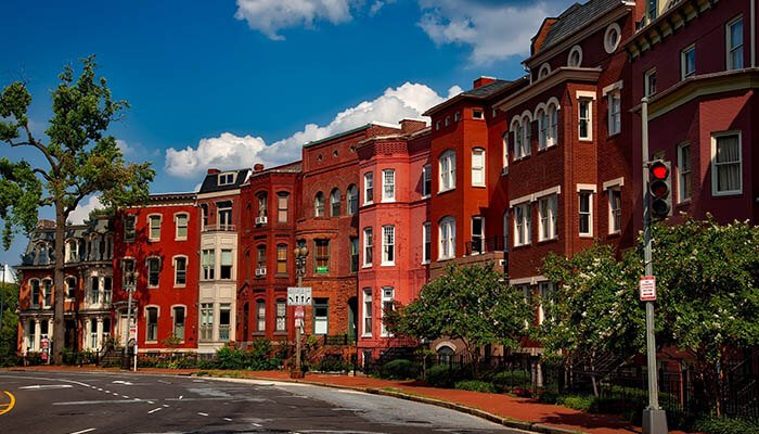A row of red brick townhouses