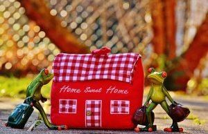 """An embroidered """"house"""" that says """"home, sweet home""""."""